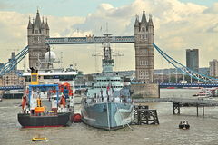Royal Research Ship Discovery moored with HMS Belfast Stock Images