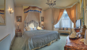 Royal room. Luxurious bedroom with great king-size bed Stock Photo
