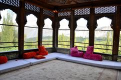 A royal room overlooking the mountains at Khaplu Palace Gilgit Baltistan Pakistan. Khaplu, Pakistan - October 3, 2016: A royal meeting room with wide open Royalty Free Stock Photo