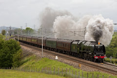 The Royal Scot. Preserved steam locomotive 46233 Duchess of Sutherland heads the Royal Scot southbound through Hackthorpe, Cumbria on June 9, 2012, on the west Royalty Free Stock Photos