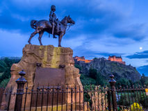 Royal Scots Greys Monument. With Edinburgh Castle in the background at night from Princes Street Stock Image