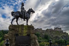 Royal Scots Greys Monument with Edinburgh Castle. In the background from Princes Street Royalty Free Stock Image