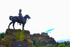 The Royal Scots Greys Monument in Princes Street with Princes St. Reet Gardens and Edinburgh Castle at background, in Edinburgh, Scotland Royalty Free Stock Photography