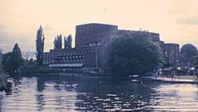 Royal Shakespeare Theatre and statue. Stratford-upon-Avon, Warwickshire, England - 1976: Shakespeare Theatre on the River Avon. Archival of Stratford-upon-Avon stock video