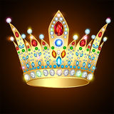 Royal shiny gold crown with precious stones and jew Royalty Free Stock Photo