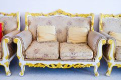 Royal sofa with pillows in beige luxurious. Interior Royalty Free Stock Image