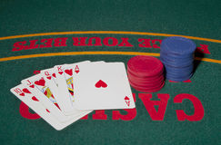 Royal Straight Flush. A Royal Straight Flush of Hearts on the table with chips stock photos