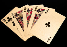 Royal straight flush golden playing cards poker hand Royalty Free Stock Photography