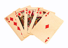 Royal straight flush golden playing cards poker hand in diamonds Stock Photo