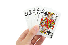 A royal straight flush playing cards poker hand in. Clubs on white background Royalty Free Stock Photography