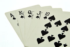 A royal straight flush playing cards poker hand. Isolate on white background Royalty Free Stock Images