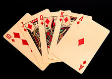 Royal straight flush playing golden cards poker hand in diamonds Royalty Free Stock Photography