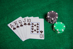 Royal Straight Flush with poker chip stacks Royalty Free Stock Photos