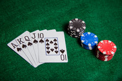 Royal Straight Flush with poker chip stacks Royalty Free Stock Images