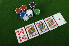 Royal straight flush and poker chips Stock Images