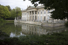 Royal summer Palace over the pond in Warsaw,Poland. Summer day , royalty free stock photography