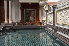 Luxury swimming pool. Decorated with wall relief and marble tiles Royalty Free Stock Image