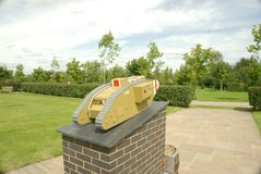 Royal Tank regiment memorial. At the national memorial arboretum in Staffordshire UK. A model of a mark 1 tank on a brick plinth with inscription and badges Royalty Free Stock Image