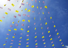 Royal and Thai national flags under blue sky Stock Photo