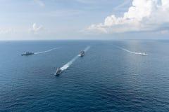 Royal Thai Navy and Royal Australian Navy warships sail in the Gulf of Thailand stock photo