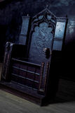 Royal throne. dark Gothic throne, side view stock photography