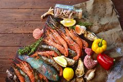 Royal and tiger shrimps, oysters, fish and ingredients for cooking. Mediterranean sea restaurant cuisine. Royal and tiger shrimps, oysters, fish and ingredients stock photo