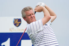 Royal Trophy golf tournament, Asia vs Europe 2010. BANGKOK, THAILAND - JANUARY 9: Scottish golf player and team captain Colin Montgomerie teeing off at the Royal Royalty Free Stock Photo