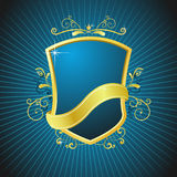 Royal vintage shield. Gold decorated shield with ribbon arround it Stock Images