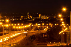 Royal Wawel castle by night with blurred traffic lights Royalty Free Stock Image