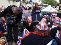 Royal wedding fans interview. Fans of the royal wedding between Prince William and Kate Middleton giving an interview while waiting for the big event. Photo Royalty Free Stock Photography
