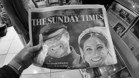 Royal Wedding in UK newspapers. London, England - May 20, 2018: POV The Sunday Express front cover newspaper in British press kiosk featuring portraits of Prince stock video
