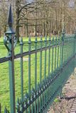 Royal wrought iron fence of Palace Soestdijk, Soest / Baarn, Netherlands. Royal wrought iron fence along the beech forest of Palace Soestdijk, Soest / Baarn Royalty Free Stock Photo