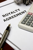 Royalty Agreement. Image of a royalty agreement on an office table royalty free stock photography