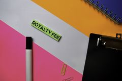 Royalty Fee text on sticky notes with color office desk concept stock photography