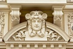 Art deco style decorations with sad man`s face stock images