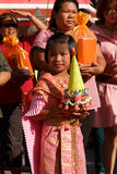 Unidentified Thai girl carry offering in hand Royalty Free Stock Images