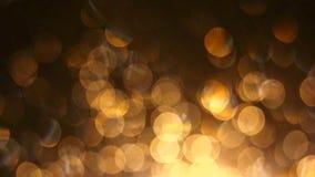 Rozblaskowego koloru żółtego deszczu zamazany bokeh zdjęcie wideo