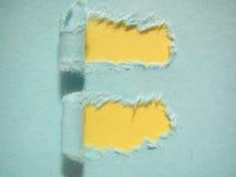 rozdzierający błękitny papier Zdjęcia Stock