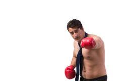 Rozdzierający biznesmen z bokserskimi rękawiczkami odizolowywać na bielu Fotografia Stock