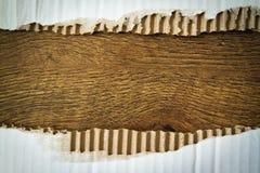 Rozdzierający koloru żółtego papier z drewno przestrzenią dla twój wiadomości Zdjęcia Stock