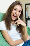 Roześmiana dziewczyna z palcem w nosie Obrazy Royalty Free