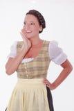 Roześmiana młoda Bawarska kobieta w dirndl fotografia royalty free