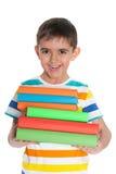 Roześmiana młoda chłopiec z książkami Zdjęcie Stock