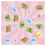 Roze achtergrond met gekleurde zakken voor het winkelen Royalty-vrije Stock Foto's