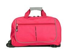 Roze bagage met wielen Royalty-vrije Stock Foto's