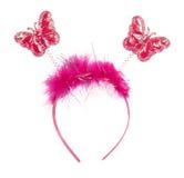 Roze band op het hoofd met vlinders Stock Afbeeldingen