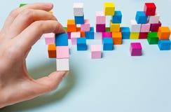 Roze, Blauwe en witte kubus ter beschikking stock foto