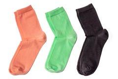 Roze, blu, zwarte die sokken op witte achtergrond worden geïsoleerd stock afbeeldingen