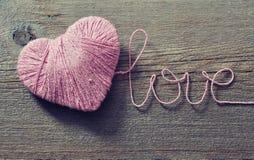 Roze clew in vorm van hart royalty-vrije stock afbeeldingen
