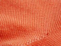 Roze de textuurachtergrond van het knitepatroon Stock Afbeeldingen